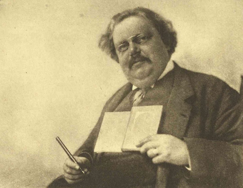 Chesterton_Holding_Book_and_Pen